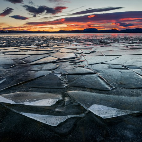 Ice foes on Lake Mývatn on a cold winter day sunrise.