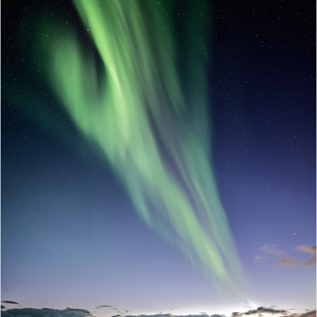 Strong Aurora Borealis during dawn.